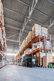 Long shelves with a variety of boxes and containers. Warehouse industrial and logistics companies. Long shelves with a variety of boxes and containers Stock Photos
