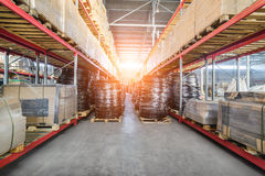 Long shelves with a variety of boxes and containers. Royalty Free Stock Images