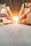 Long shelves with a variety of boxes and containers. Warehouse industrial and logistics companies. The boxes on high shelves stocked. Bright sunlight Stock Images