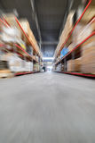 Long shelves with a variety of boxes and containers. Warehouse industrial and logistics companies. Many boxes packed in a black stretch film. The boxes on high Stock Photography