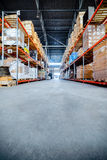 Long shelves with a variety of boxes and containers. Royalty Free Stock Photos