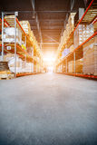 Long shelves with a variety of boxes and containers. Stock Images