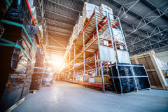 Long shelves with a variety of boxes and containers. Warehouse industrial and logistics companies. Long shelves with a variety of boxes and containers. Toning Royalty Free Stock Photo