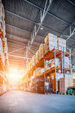Long shelves with a variety of boxes and containers. Warehouse industrial and logistics companies. Long shelves with a variety of boxes and containers. Toning Royalty Free Stock Images