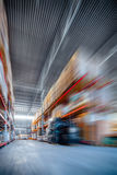 Long shelves with a variety of boxes and containers. Warehouse industrial and logistics companies. Long shelves with a variety of boxes and containers. Toning Stock Photos
