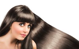 Long shiny hair of a beautiful brunette Royalty Free Stock Photography