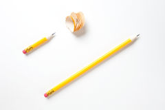 Long and a short pencil on textured white paper Stock Photography