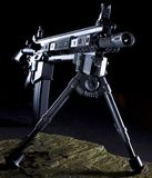 Long shot. Modern assault rifle with a bipop ready for a long shot from the dark Royalty Free Stock Photos