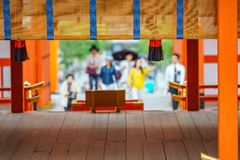 Blurred believers praying in japanese temple. Long shot of blurred believers praying in japanese temple, focus on foreground Stock Images