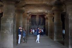 Long shot from the corridor of Trimurti three idols at Elephanta Caves, Mumbai, India royalty free stock photos