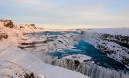 Long shot of Gullfoss waterfall in Iceland. A long shot of the Gullfoss waterfall with turquoise water in Iceland during sunset in winter Royalty Free Stock Photo