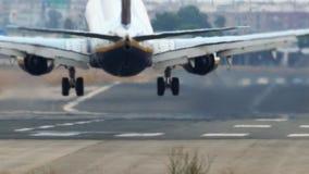 Jet plane landing with smoke on runway