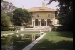 Long shot of large mansion stock video footage