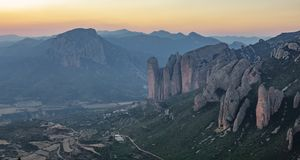 Mallos of Riglos in Huesca, long shot after sunset. Long shot of Mallos of Riglos after sunset, Huesca Spain Royalty Free Stock Photo