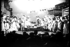 Long shot of men wearing horse costume performing with female dancers on stage stock video footage