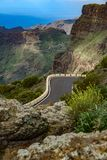 Mountain road and dangerous curve near precipice. Long shot of mountain road and dangerous curve near precipice royalty free stock image