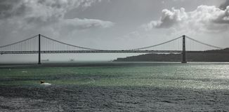 Long shot panorama of 25 de Abril Bridge in Lisbon Stock Photo