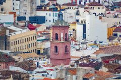Church tower over houses Stock Photography