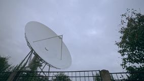 Long shot of the satellite array with trees. View of the satellite array with trees stock footage