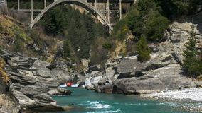 Long shot of the shotover jet and the hstoric edith cavell bridge. Near queenstown royalty free stock photo