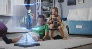 Children watching holographic animated movie