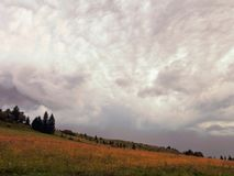 Cloudy Sky, Dark Clouds, Close Storm Over Mountain Hill. Stock Images