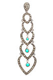 Long silver earring with turquoise Royalty Free Stock Photography