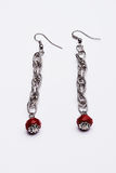 Long silver earrings with red gems Stock Photo