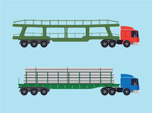 Long-size trucks. Two trucks with various trailers. One for transportation vehicles and one for long goods, pipes, beams, slabs Stock Photography
