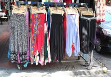 Long skirts at street market Stock Photo