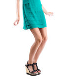 Long slim elegant female legs with shoes isolated on white background. Royalty Free Stock Photography