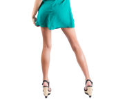 Long slim elegant female legs with shoes isolated on white background. Stock Images