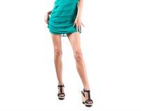 Long slim elegant female legs with shoes isolated on white background Royalty Free Stock Image