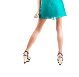 Long slim elegant female legs with shoes isolated on white background Royalty Free Stock Photography