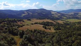 A long and slow aerial helicopter shot of beautiful green mountain stock video