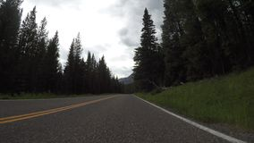 Long slow curve in Wyoming mountains. Near Yellowstone stock video footage