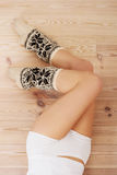 Long smooth beautiful legs with high warm socks. Royalty Free Stock Photography