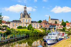 Long, Somme, France. Long is a commune in the Somme department in Hauts-de-France in northern France. Here a view of the weir in the River Somme with marina and royalty free stock images