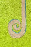 Long spiral decorated on green wall cement Royalty Free Stock Photos