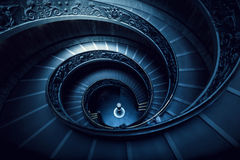 Long spiral, winding stairs. Dark shadows, soft light. stock image