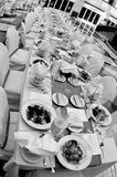 Long spread. Long table at indoor wedding reception.  Black & white Royalty Free Stock Photo