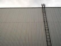 Long stair. On big metal wall