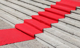 Long staircase with a luxurious red carpet Royalty Free Stock Image