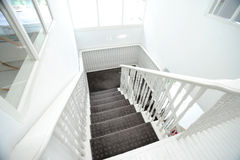 Long stairs. Long white stairs in white room Stock Photos