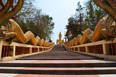Long stairs to Buddha Statue in Thailand. Stock Image
