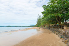 Long stane wall at Hat Nopparat Thara beach Krabi Royalty Free Stock Images