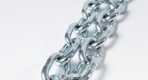 Long steel chain strong protection, white background Royalty Free Stock Photography