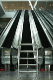 Long steel escalators Stock Image