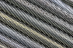 Long steel screws thread background Royalty Free Stock Image