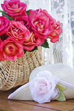 Long stem roses and a sun hat Royalty Free Stock Images